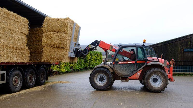 The ever helpful Gordon unloading our straw